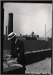 Tenement House Dept inspector on rooftop: Manhattan