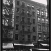 [Storefronts and vacant tenement: 154-158  [street unknown], Manhattan]
