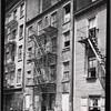 [Tenement row with vacant tenement: Manhattan]