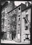 Tenement row with vacant tenement: Manhattan