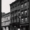 [Wooden row houses and storefronts; Home of Satisfaction Cleaning: 33 [street unknown], Manhattan]