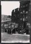 Tenement row, demolition in progress: Manhattan