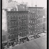 [Tenements and storefronts with Christmas lights, from Elevated line: 1st Ave. - E. 12th St., Manhattan]