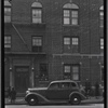 [Brick row house; watchmaker on first floor, shoeshine stand outside: Saratoga Ave.-Riverdale Av-Livonia, Brooklyn]