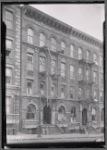 Tenement row; barber in first floor apartment
