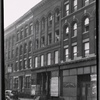 [Tenements & vacant storefronts; Jay Bee Syrup Co.: 3426 [street unknown], Bronx]