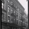 Tenements & storefronts; Tom's Bird Store
