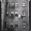 Tenement rear view with family posed in window