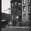 [Vacant row houses; Old Reliable Barber Shop: 133 [street unknown]]