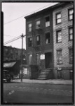 Vacant row houses; Old Reliable Barber Shop: 133 [street unknown]]