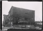 Demoliton of wood frame row houses in progress