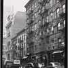 Tenements & storefronts; police car