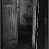 """Outhouse interior with """"Clean Hands"""" sign"""