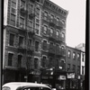 [Tenements & storefronts; Scandron's Opticians: 399-403 Grand St.-Clinton-Suffolk, Manhattan]
