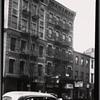 [Tenements & storefronts; Scandron's Opticians: 399-403 Grand St.-Clinton-Suffolk, Manhattan]