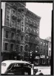 Tenements & storefronts; Scandron's Opticians: 399-403 Grand St.-Clinton-Suffolk, Manhattan