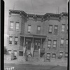 [Stone rowhouses; two women in front: 5211-5213 [street unknown] ]