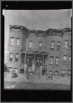 Stone rowhouses; two women in front: 5211-5213 [street unknown] ]