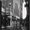 [Strefronts & elevated train tracks; Checker Beverage Co, Sherbel's coats: 3112 [street unknown]]
