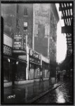 Strefronts & elevated train tracks; Checker Beverage Co, Sherbel's coats: 3112 [street unknown]]