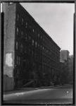 Tenement row with storefronts; Adriatic Café: Manhattan