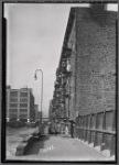 Tenement row, West Side; General Motors Taxicabs : Manhattan