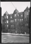 Queen Anne style row houses; children outside
