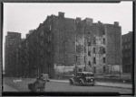 Vacant tenement row; playground; United Motors Service: W. 64th St.-Amsterdam-West End, Manhattan