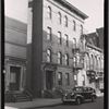 [Row of small apartment buildings: 663-667 [street unknown]]