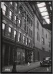 Tenements & storefronts; El tracks; Bishop's Crook lamp post