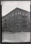 Apartment building; women and children outside: Bronx