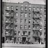 [Apartment with L. Holman (?) Furrier and Betty's Beauty Shoppe: 1205 or 1209 [street unknown], Bronx]