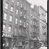 [Tenements & storefronts; Sam Fisher Tailor, Ave C Tire, Schlesinger's Bakery: 25-31 Av C-E. 2nd St-E. 3rd St, Manhattan]