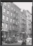 Tenements & storefronts; Sam Fisher Tailor, Ave C Tire, Schlesinger's Bakery: 25-31 Av C-E. 2nd St-E. 3rd St, Manhattan
