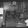 [Interior view of tailoring workshop; man at presser: Manhattan]