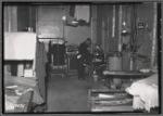 Interior view of tailoring workshop; man at presser: Manhattan