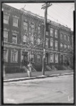 Row houses; furnished room for rent signs: Bronx