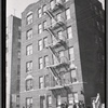 [Apartment house; residents outside with children: Bronx]