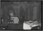 Tenement interior with beds and dining table