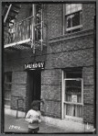 Paramount Laundry in ground floor apartment; closer view of #19468: 76 St. Nicholas Place- W. 153rd St., Manhattan