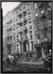 Tenements & storefronts; Glass store, barber: 52 [street unknown]]