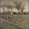 One of the 74 temporary homes. The permanent adobe structures are now under construction. Bosque Farms Project