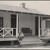Irwinville Farms, Georgia. House of Charles Foster. Exterior [with] two children of client on porch.