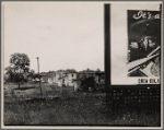 Houses with partial view of billboard advertising Coca-Cola in foreground. West Virginia?