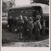 The  children from Dead Ox Flat get off the bus at the school yard. Ontario, Malheur County, Oregon. General caption number 67-1V