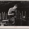 Jack Cutter, resident of FSA (Farm Security Administration) trailer camp, winding an armature at General Electric plant. Erie, Pennsylvania.