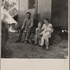 Marysville migrant camp. California fruit tramp and his family (mother, twenty-two years old)