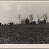 General vista of houses and field, Cumberland Homesteads. Crossville, Tennessee.