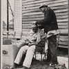 Negro getting a haircut in front of church which houses flood refugees. Sikeston, Missouri.