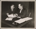 Creditor and debtor signing agreement of farm debt adjustment. Champaign, Illinois.